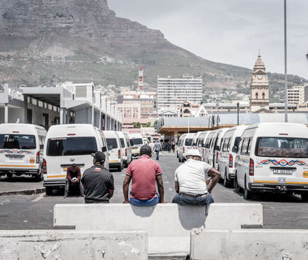 cape Town, South Africa, February 9, 2018: Taxi drivers taking a break on the upper deck of Cape Town Station near Civic Centre in Cape Town, South Africa Editorial