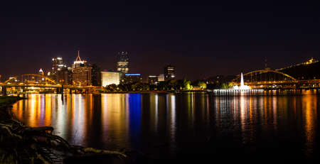 Panoramic nighttime view of Pittsburgh skyline from the confluence of Allegheny and Monongahela rivers