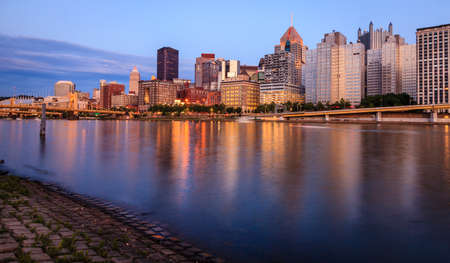 View of Pittsburgh skyline from the Allegheny River after sunset Stock Photo