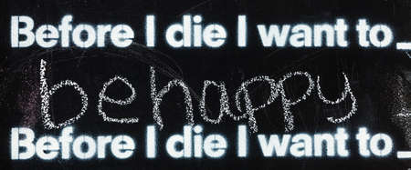 Fragment of a blackboard reading: Before I die I want to be happy Stock Photo