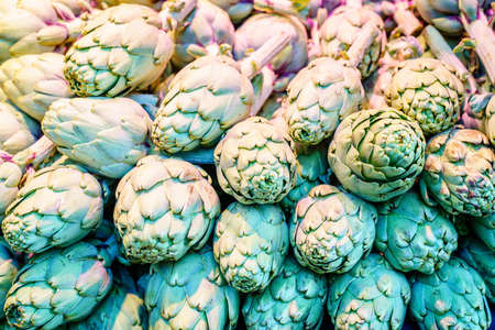 Artichokes on display at a farmers market in Barcelona, Spain
