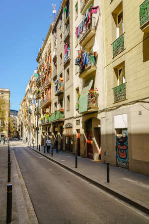 Barcelona, Spain, April 21, 2017: residential buildings facades with drying laundry in Barcelona, Spain Editorial