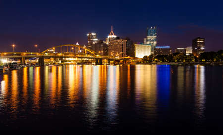 Nighttime view of Pittsburgh skyline from the confluence of Allegheny and Monongahela rivers
