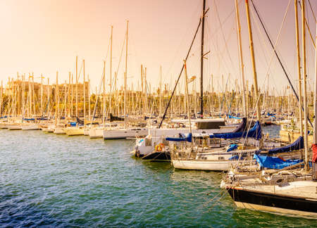 Sailboats docked at the marina in Barcelona on a bright spring day Stock Photo