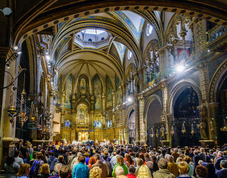 Montserrat, Spain, April 23, 2017: People are gathered in the Basilica of Montserrat for LEscolania Choir performance Editöryel