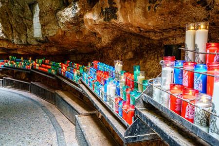 Montserrat, Spain, April 23, 2017: Prayer candles in Santa Maria de Montserrat monastery