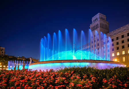Nighttime view of the fountains on Plaza de Catalunya in Barcelona, Spain