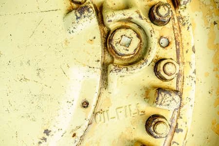 Close-up image of old machinery part with oil fill port