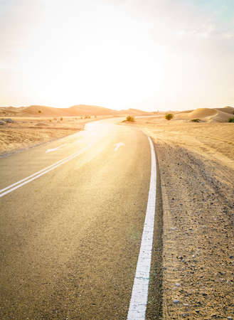 Empty highway through desert near Al Ain in UAE. Stok Fotoğraf