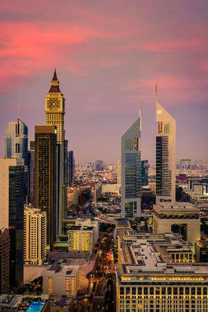 Birds eye view of Dubai Financial District skyline at sunset Imagens