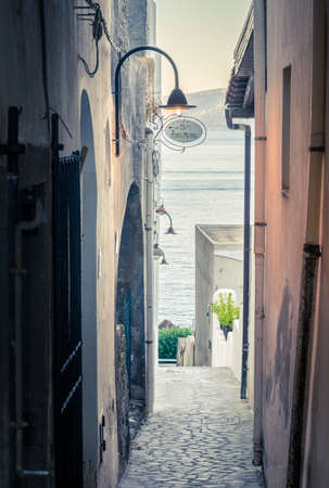 View down a pedestrian street in the town of Santa Marina on Salina island in Italy