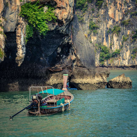Traditional Thai boat near entrance to a lagoon in Koh Hong island in Andaman Sea