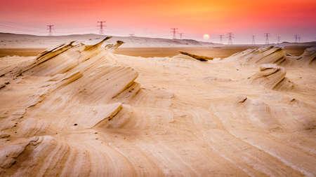 Scenic sunset over sandstone formations in Abu Dhabi desert in UAE