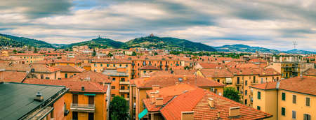 Panoramic view of rooftops and suburban hills in Bologna, Italy