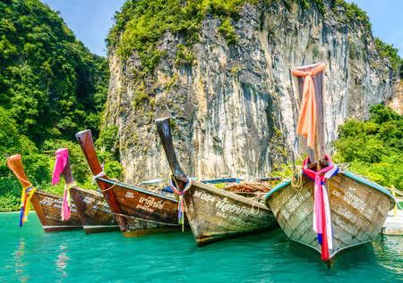Krabi, Thailand, November 7, 2017: Traditional Thai motor boats on an island in the Andaman Sea in Krabi, Thailand