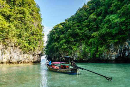 Krabi, Thailand, November 7, 2017: Traditional Thai motor boat by the entrance to  a lagoon on Ko Hong island