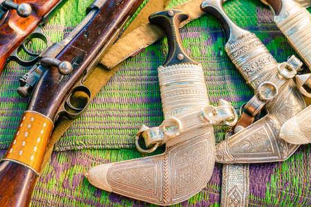 Khanjars and rifles on display at the gun Friday market in Nizwa, Oman