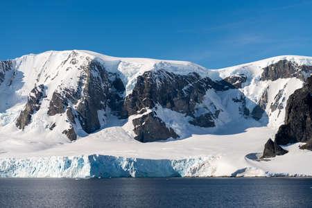 Antarctic landscape with iceberg at sea