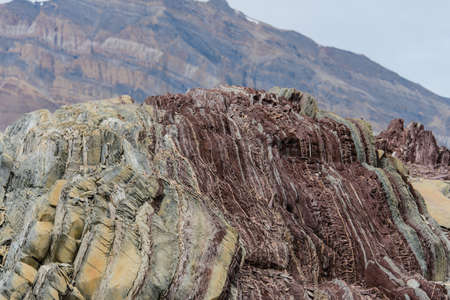 Colourful rocks in east Greenland close up. Rock texture.