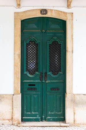 Green wooden door in old european city 免版税图像