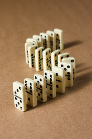 White dominoes on a brown textured background Stock Photo