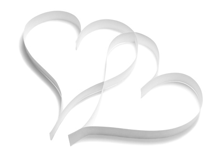 Pair of paper hearts on white background