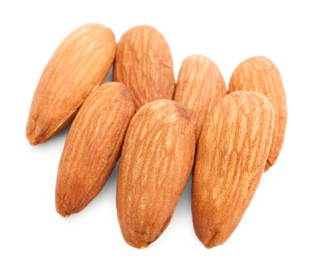 Heap of almonds isolated on white background