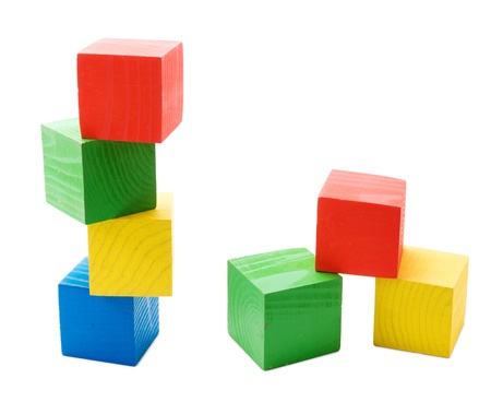 Wooden colored cubes tower toys isolated on white background Stock Photo - 12834004