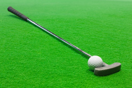 putt: Mini Golf club and ball on the artificial grass