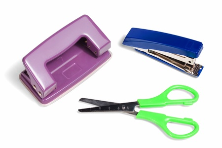 puncher: Office stationery, stapler, puncher and scissors isolated on white