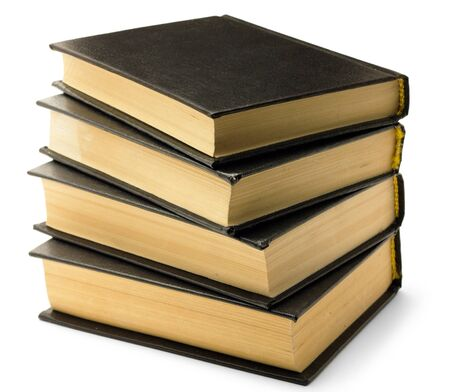 Stack of old black books isolated on white background photo