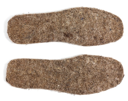 Felt insoles for shoes isolated on white background Stock Photo