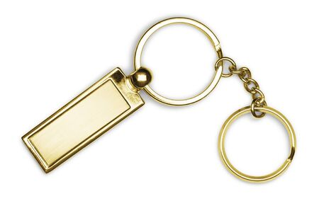 Golden keychain with chain and rings isolated on white background photo