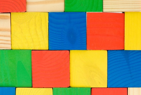 Colourful wall from toys wooden cubes background