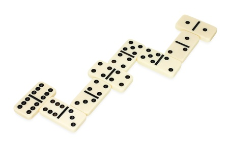 dominoes lying on the table in snake shape isolated on white background