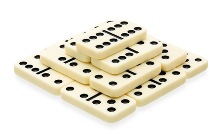 Domino building in the shape of pyramid on white background