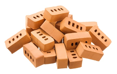 Heap of bricks isolated on white background