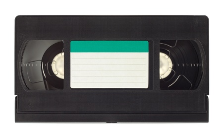 videocassette: Old video cassette with empty label isolated on white background