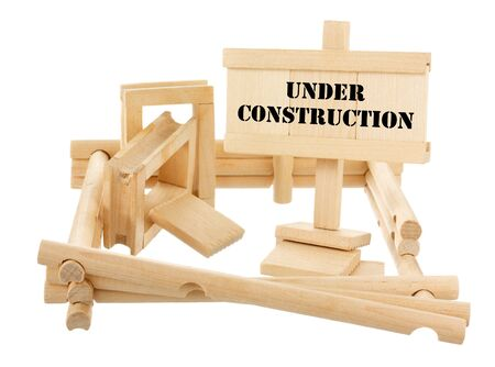 Under construction unfinished wooden house isolated on white Stock Photo - 13824110