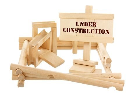 Under construction unfinished wooden house isolated on white