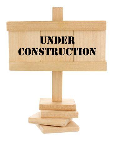 In costruzione tavoletta di legno isolato su bianco Archivio Fotografico - 13824113