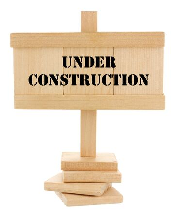 Under construction wooden tablet isolated on white
