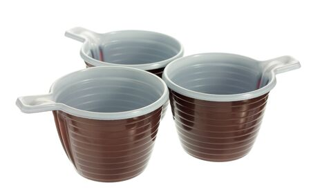 Group of three empty disposable plastic brown coffee cups isolated on white background photo