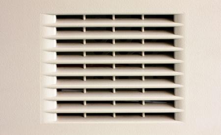 scored: Gray plastic ventilation grille closeup view
