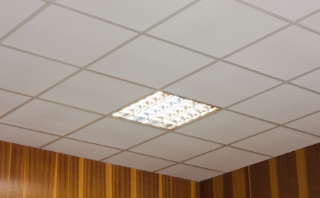 ceiling texture: White office ceiling with built-in fluorescent lamp Stock Photo