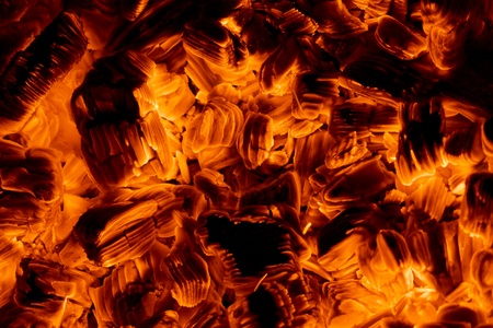 Burning embers in the dark close-up view, red textured background Stock Photo - 15136300