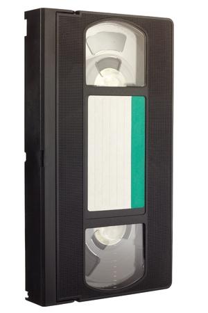 videocassette: Old VCR una cinta de v�deo con etiqueta vac�a en la vista diagonal aislada en el fondo blanco Foto de archivo
