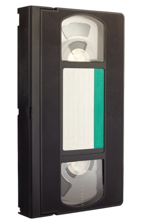 videocassette: Old VCR video tape with empty label in diagonal view isolated on white background Stock Photo