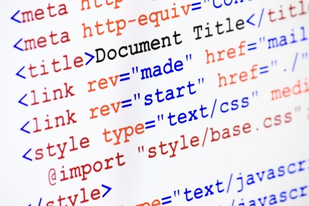 Web page HTML source code with document title, metadata description and links monitor screenshot diagonal view, small depth of sharpness Archivio Fotografico