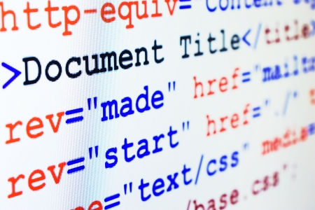 HTML source code of web page with document title, metadata description and links monitor screenshot diagonal view, small depth of sharpness Stock Photo - 16236693